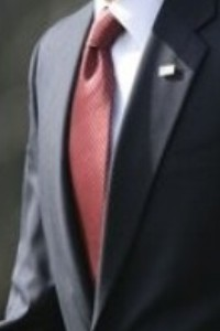 Neck of State: Barack Obama changes the destiny of the world while wearing a burgundy patterned neck tie on February 27, 2009.
