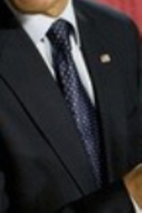 Neck of State: Barack Obama wears a dark blue neck tie with white dots while attending a police academy graduation in Columbus, Ohio on March 6, 2009.