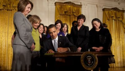 President Barack Obama signs an Executive Order creating the White House Council on Women and Girls. March 11, 2009.